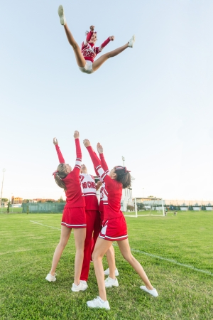 pom pom: Group of Cheerleaders Performing Stunts Editorial
