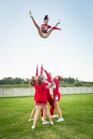 Group of Cheerleaders Performing Stunts Editorial