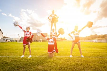 Group of Cheerleaders in the Field Editorial