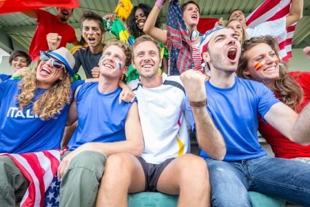 sport fan: Supporters from Multiple Countries at Stadium All Together Editorial