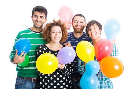 baloons: Friends at Party Playing with Colorful Baloons Stock Photo