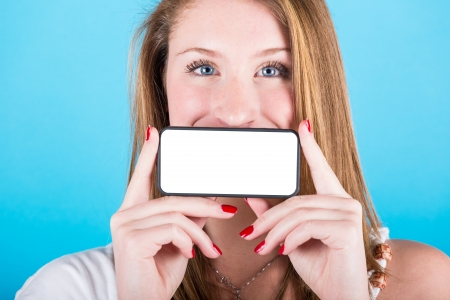 Smiling Girl Holding Smartphone with Blank Screen photo