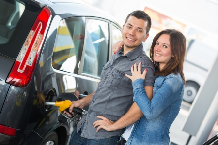 petrol stations: Young Couple at Gas Station