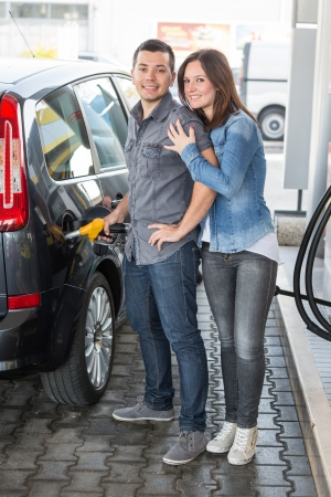 Young Couple at Gas Station photo