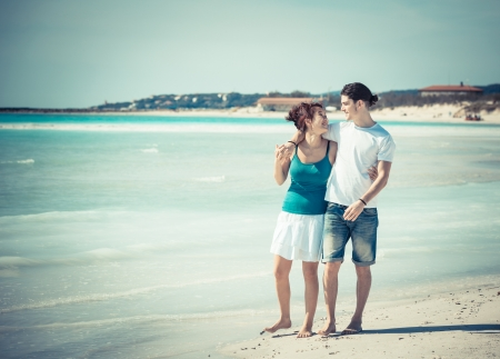 Young Couple Walking on Caribbean Beach photo