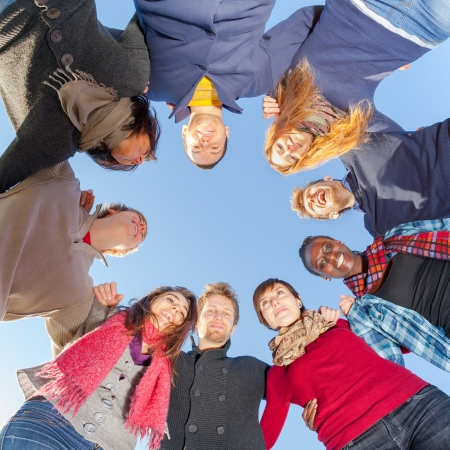 congregation: Multiracial People Holding Hands in a Circle, Low Angle View