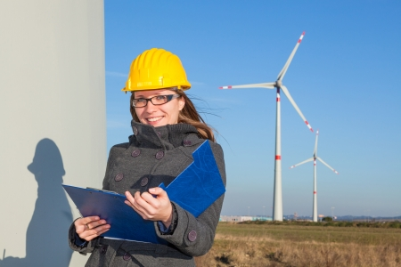 female engineer: Female Engineer in a Wind Turbines Farm Stock Photo