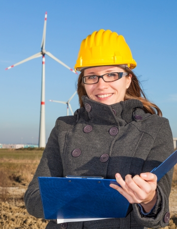 energy work: Female Engineer in a Wind Turbines Farm Stock Photo
