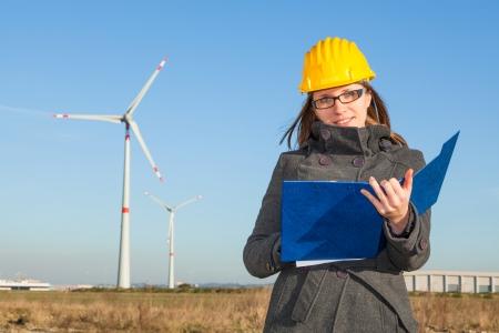 Female Engineer in a Wind Turbines Farm Stock Photo