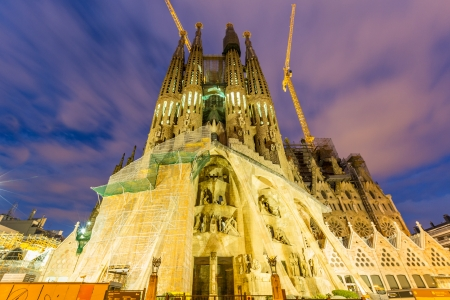 BARCELONA, SPAIN - FEBRUARY 27, 2013: Sagrada Familia at twilight. Designed by Antoni Gaudì, the church is still incomplete.