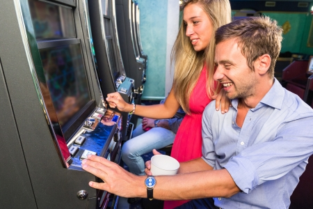arcade games: Group of Friend Playing with Slot Machines