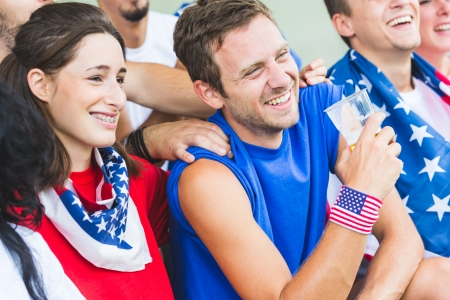 cheering fans: American Supporters at Stadium Stock Photo