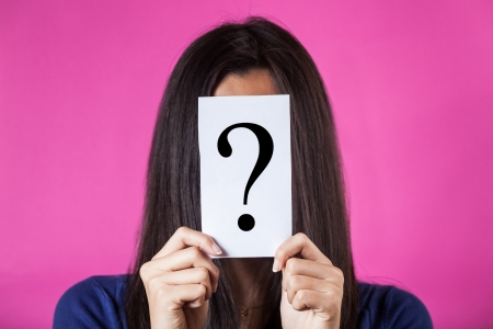 questions: Woman Hiding Face Behind a Question Mark
