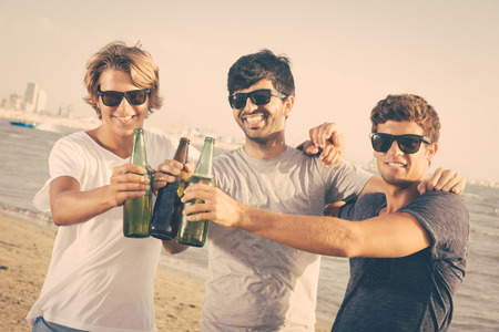 drunk party: Group of Boys Cheering at Beach