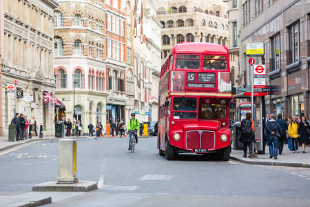 london: LONDON, UNITED KINGDOM - OCTOBER 24, 2013: Famous red Double-Decker at Monument bus stop