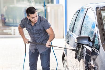 Young Man Cleaning Car photo