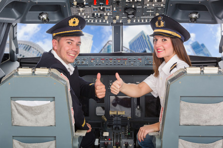 airline pilot: Pilots in the Cockpit Stock Photo