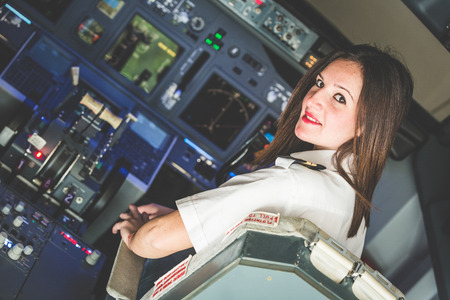 airplane: Female Pilot in the Airplane Cockpit Stock Photo