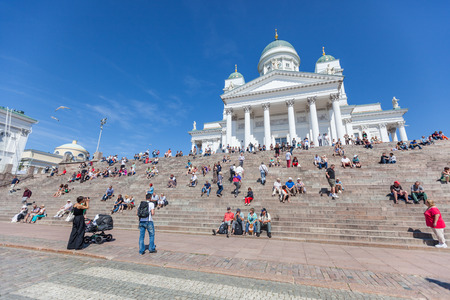 HELSINKI, FINLAND - JUNE 28, 2013: Tourists in front of Lutheran Cathedral in Helsinki