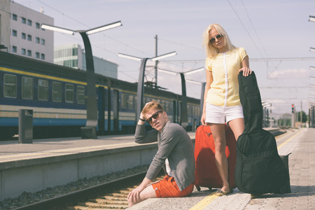 baggage train: Young Couple Waiting at Train Station