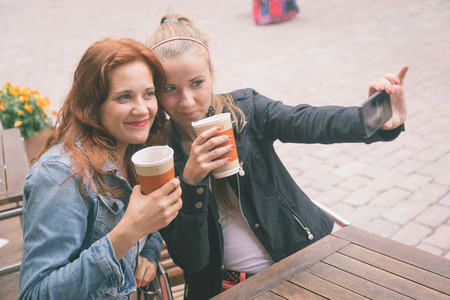 estonia: Girls Taking Pictures with Mobile Phone Stock Photo