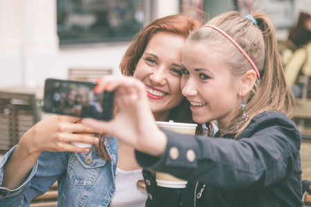 Girls Taking Pictures with Mobile Phone Stock Photo