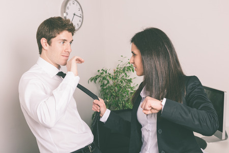 couple fight: Bully Businesswoman Holding Colleagues Necktie