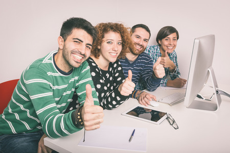young adult man: Happy Group of Friends Studying Stock Photo