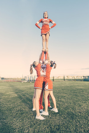 pom pom: Group of Cheerleaders in the Field Stock Photo