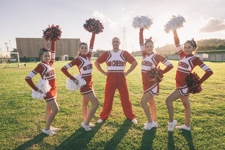 pom: Group of Cheerleaders in the Field Stock Photo