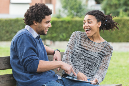 Mixed-Race Couple Using Digital Tablet photo