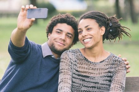 Mixed-Race Couple Taking Selfie