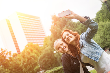 Girls Taking Selfie Mobile Phone photo