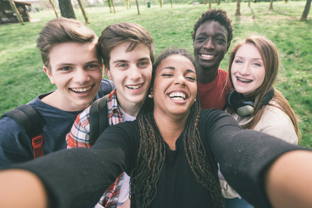 multiracial groups: Group of Multiethnic Teenagers Taking a Selfie
