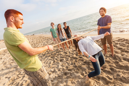 vacationers: Friends Dancing Limbo at Beach