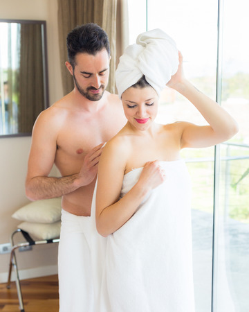 Young Couple at Hotel Room after Shower photo
