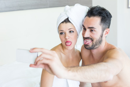 Couple Taking Selfie after Shower photo