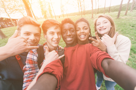 teens: Group of Multiethnic Teenagers Taking a Selfie