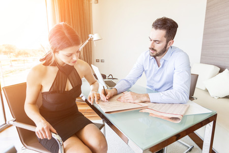 legal advice: Young Woman with Financial Consultant Stock Photo