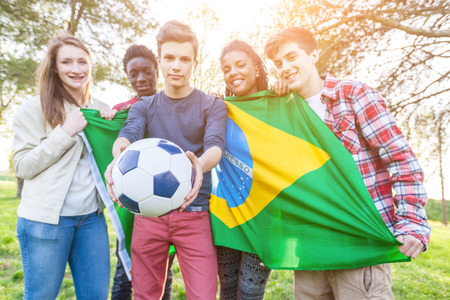 Teenage Friends Holding Brazilian Flag and Soccer Ball photo