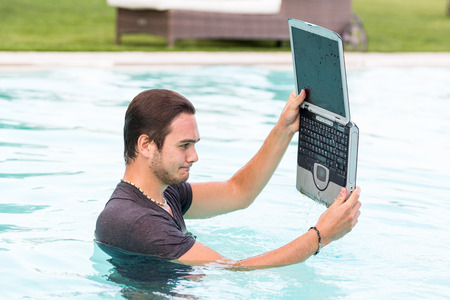 Ma with Computer in the Swimming Pool photo