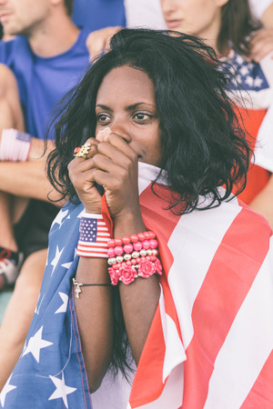 sports fans: Worried American Supporters at Stadium Stock Photo