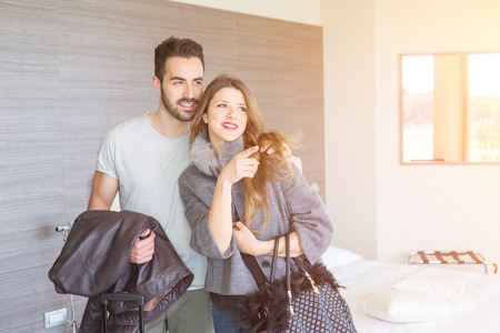 hotel suite: Young Couple at Hotel Room