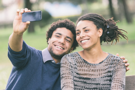 Mixed-Race Couple Taking Selfie photo