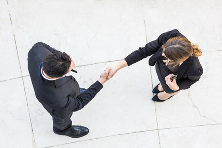 Business People Giving Handshake, Aerial View photo