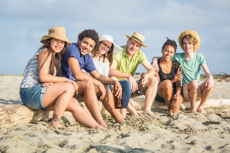 vacationers: Multiracial Group of Friends at Beach
