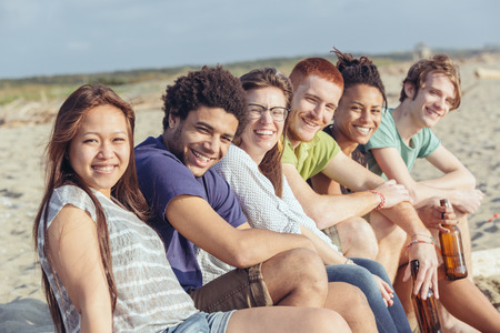 mixed race person: Multiracial Group of Friends at Beach