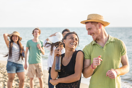 vacationers: Multiracial Group of Friends Having a Party at Beach