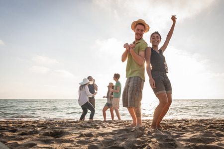 Multiracial Group of Friends Having a Party at Beach photo