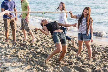 limbo: Friends Dancing Limbo at Beach